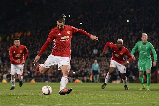 Manchester United's Swedish striker Zlatan Ibrahimovic shoots from the penalty spot to score his team's third goal during the UEFA Europa League Round of 32 first-leg football match against Saint-Etienne February 16, 2017 (AFP Photo/Oli SCARFF )