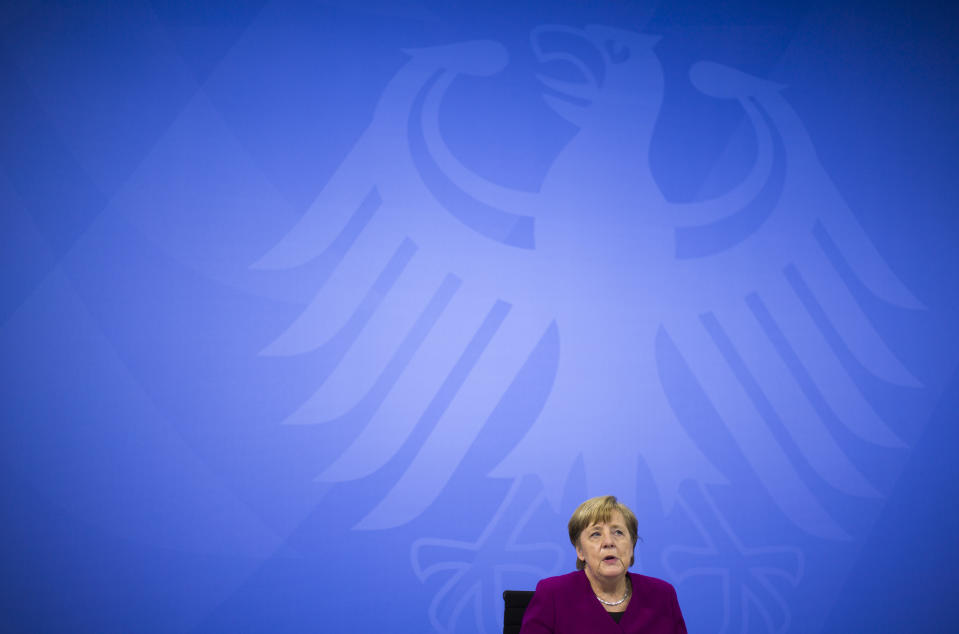 CORRECTS DAY - German Chancellor Angela Merkel attends a news conference with Bavarian state governor Markus Soeder and the Mayor of Berlin Michael Mueller after a meeting at the chancellery in Berlin, Germany, Wednesday, March 3, 2021. German Chancellor Angela Merkel conferred with the governors of the country's 16 states to discuss how to move forward with coronavirus restrictions (AP Photo/Markus Schreiber, Pool)