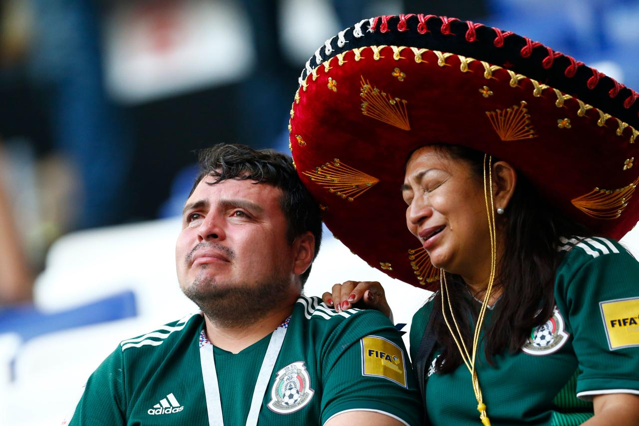 <p>Two Mexico fans react to their team's defeat after the Russia 2018 World Cup round of 16 football match between Brazil and Mexico at the Samara Arena in Samara on July 2, 2018. (Photo by BENJAMIN CREMEL / AFP) </p>