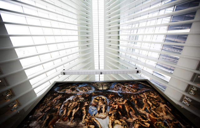 "<p>""The Last Judgement"" stands above the ""Up Close: Michelangelo's Sistine Chapel"" re-creation exhibit at the Oculus at Westfield World Trade Center in New York. The exhibit features 34 reproductions, including ""The Creation of Adam."" (AP Photo/Michael Noble Jr.) </p>"