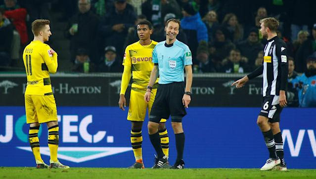 Soccer Football - Bundesliga - Borussia Moenchengladbach vs Borussia Dortmund - Borussia-Park, Moenchengladbach, Germany - February 18, 2018 Borussia Monchengladbach's Christoph Kramer reacts after his team have a goal disallowed by Referee Bastian Dankert after referring to VAR (Video Assistant Referee) as Borussia Dortmund's Marco Reus looks on REUTERS/Thilo Schmuelgen DFL RULES TO LIMIT THE ONLINE USAGE DURING MATCH TIME TO 15 PICTURES PER GAME. IMAGE SEQUENCES TO SIMULATE VIDEO IS NOT ALLOWED AT ANY TIME. FOR FURTHER QUERIES PLEASE CONTACT DFL DIRECTLY AT + 49 69 650050