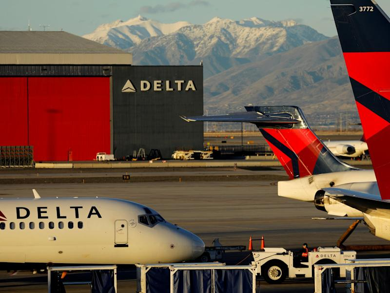 FILE PHOTO: A Delta Air Lines flight is pushed put of its gate at the airport in Salt Lake City, Utah, U.S., January 12, 2018. REUTERS/Mike Blake/File Photo