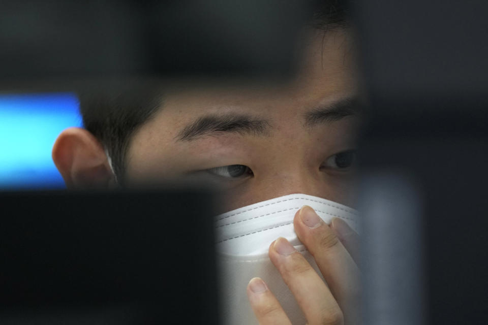 A currency trader watches monitors at the foreign exchange dealing room of the KEB Hana Bank headquarters in Seoul, South Korea, Thursday, Sept. 23, 2021. Asian shares were mostly higher on Thursday after the Federal Reserve signaled it may begin easing its extraordinary support measures for the economy later this year.(AP Photo/Ahn Young-joon)