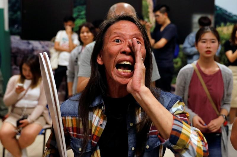 A woman reacts during the counting of the votes of the Hong Kong council elections