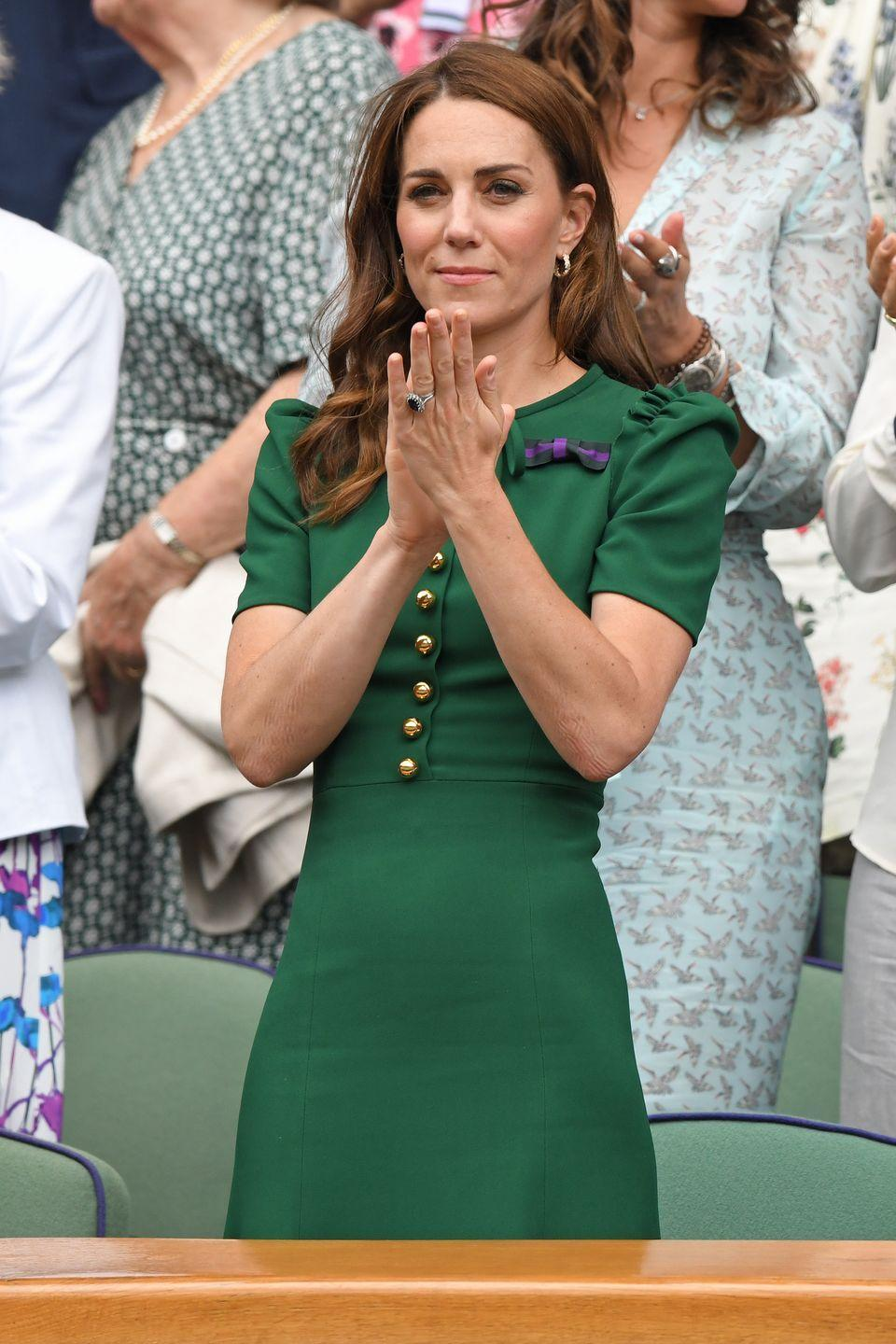 <p>The Duchess of Cambridge wore a green dress by Dolce & Gabbana during day 12 of the Wimbledon Tennis Championships. </p>