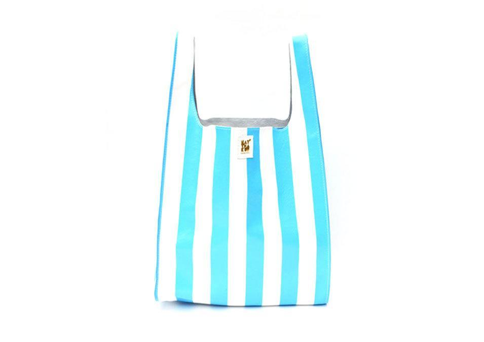 """<p>Natalie Thakur leather striped grocery bag in blue or red stripe, $199, <a href=""""http://www.natthakur.com/collections/bags/products/leather-striped-grocery-bag"""" rel=""""nofollow noopener"""" target=""""_blank"""" data-ylk=""""slk:natthakur"""" class=""""link rapid-noclick-resp"""">natthakur</a></p>"""