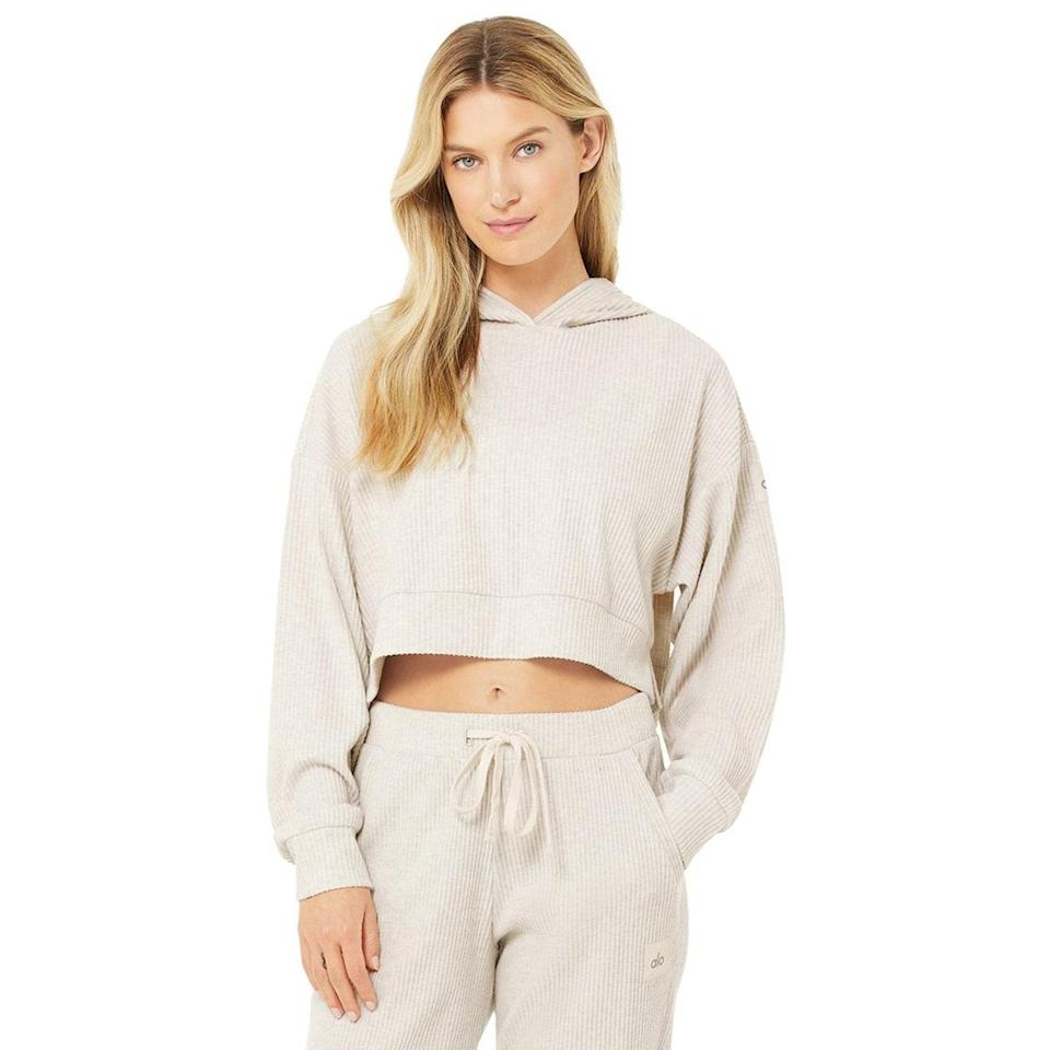 """Whether you're heading out for a laid-back day of errands or you need an extra layer for your workout ensembles, you can't go wrong with a simple ribbed-knit hoodie like this. It's the essential staple you'll reach for so often, it might be worth grabbing it in a few colors while it's on sale. $88, Alo. <a href=""""https://www.aloyoga.com/products/w3438r-muse-hoodie-bone-heather"""" rel=""""nofollow noopener"""" target=""""_blank"""" data-ylk=""""slk:Get it now!"""" class=""""link rapid-noclick-resp"""">Get it now!</a>"""