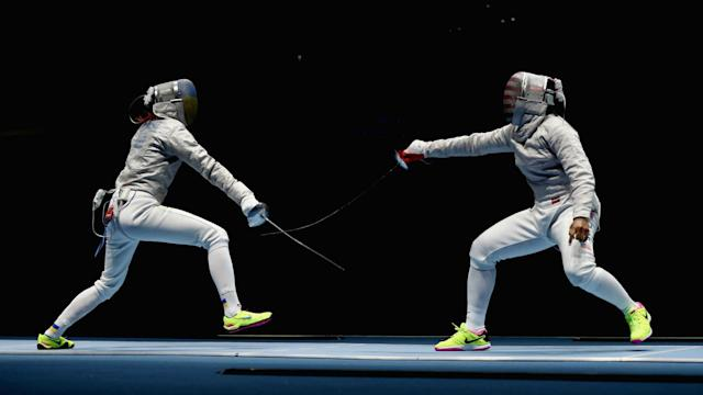 The 30-year-old won her women's individual sabre match, the first in which a U.S. competitor wore a Muslim head scarf called a hijab.