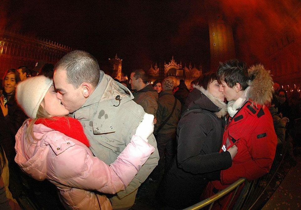 <p>Midnight kissing is taken up a notch in Venice, Italy where a NYE kissathon is held in St. Mark's Square. The event attracts around 70,000 people every year.</p>