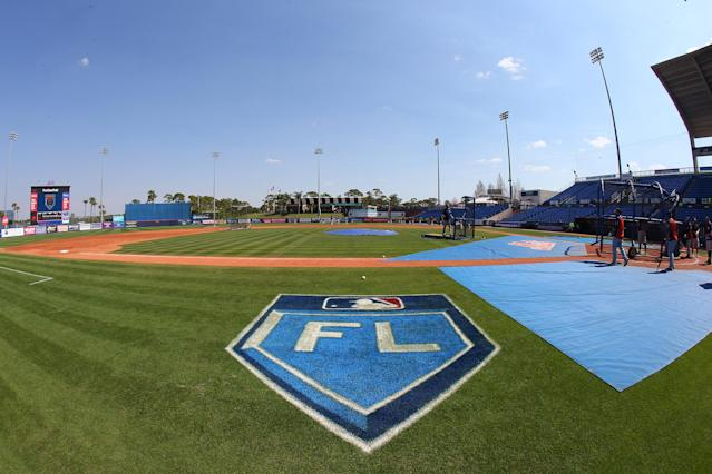 "The Grapefruit League logo on the third base line before a spring training game between the <a class=""link rapid-noclick-resp"" href=""/mlb/teams/hou/"" data-ylk=""slk:Houston Astros"">Houston Astros</a> and <a class=""link rapid-noclick-resp"" href=""/mlb/teams/nym/"" data-ylk=""slk:New York Mets"">New York Mets</a>. (Getty)"