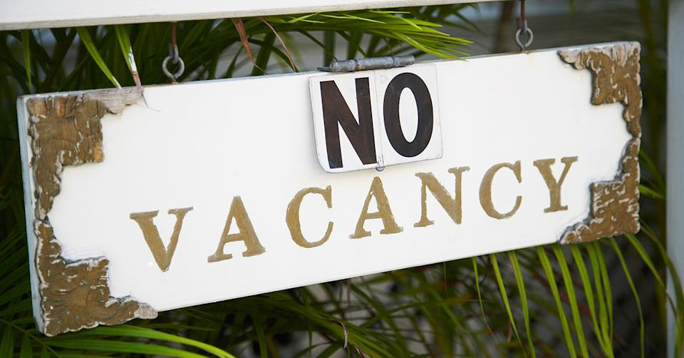 Hotel no vacancy sign. Photo: Getty Images.