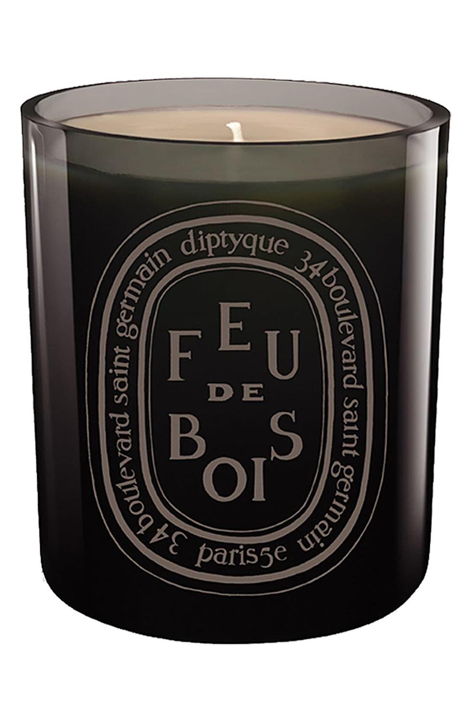 """<p><strong>Diptyque </strong></p><p>nordstrom.com</p><p><strong>$98.00</strong></p><p><a href=""""https://go.redirectingat.com?id=74968X1596630&url=https%3A%2F%2Fshop.nordstrom.com%2Fs%2Fdiptyque-feu-de-bois-wood-fire-grey-scented-candle%2F3228197&sref=https%3A%2F%2Fwww.townandcountrymag.com%2Fleisure%2Fg12237114%2Fbest-thanksgiving-hostess-gift-ideas%2F"""" rel=""""nofollow noopener"""" target=""""_blank"""" data-ylk=""""slk:Shop Now"""" class=""""link rapid-noclick-resp"""">Shop Now</a></p><p>The ultimate sign of gratitude is a lovely seasonal candle that will make your host or hostess feel stylish the minute they strike a match.</p>"""