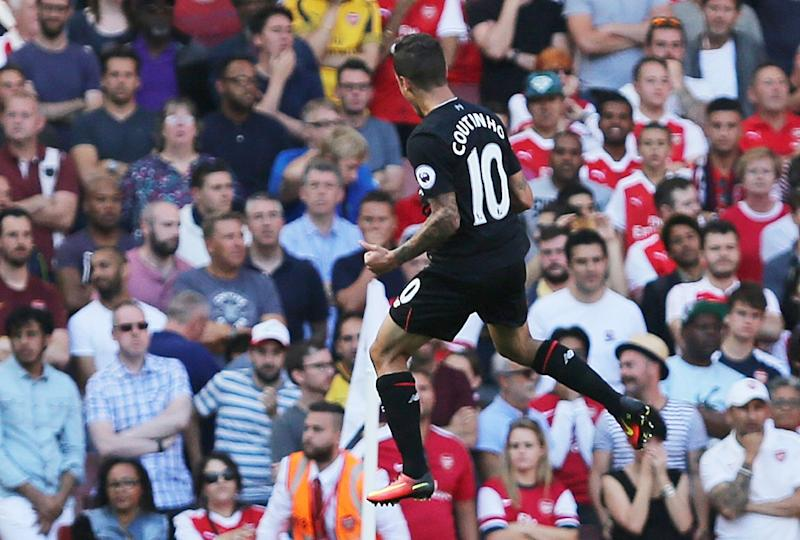 Liverpool's Philippe Coutinho celebrates scoring a goal during their English Premier League match against Arsenal, at the Emirates Stadium in London, on August 14, 2016