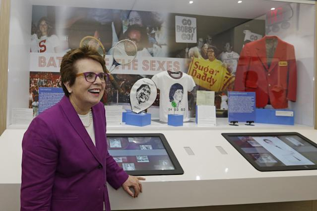 In this photo taken Sept. 5, 2013, Billie Jean King reflects about her match against Bobby Riggs in 1973 as she stands in front of a display during the U.S. Open tennis tournament in New York. Friday, Sept. 20, 2013, is the 40th anniversary of Kings's straight-set victory over Riggs in front of more than 30,000 fans. (AP Photo/Darron Cummings)