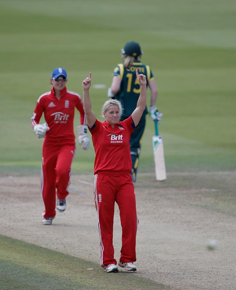 LONDON, ENGLAND - AUGUST 20: Katherine Brunt of England celebrates dismissing Erin Osborne of Australia (not pictured) during the first NatWest One Day International match between England and Australia at Lord's Cricket Ground on August 20, 2013 in London, England.  (Photo by Harry Engels/Getty Images)