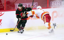 Ottawa Senators right wing Connor Brown (28) skates the puck away from Calgary Flames defenseman Juuso Valimaki (6) during third period NHL hockey action in Ottawa on Monday, March 1, 2021. (Sean Kilpatrick/The Canadian Press via AP)