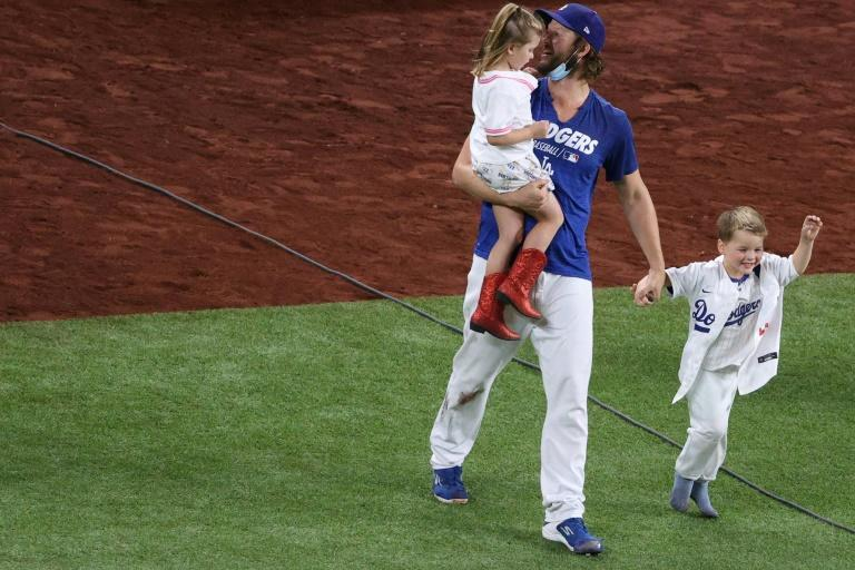 Los Angeles ace pitcher Clayton Kershaw celebrates with daughter Cali Ann and son Charley after the Dodgers' World Series-clinching win over the Tampa Bay Rays