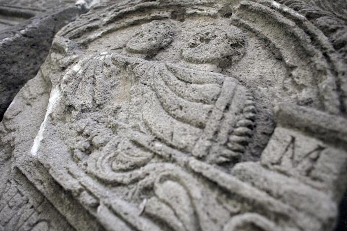 This Friday, Oct. 5, 2012 photo shows mid relief on a Roman tombstone , found on the site of Ratiaria, an ancient Roman settlement located on the banks of the Danube, in the northwest corner of Bulgaria. Located on the crossroads of many ancient civilizations, Bulgarian scholars rank their country behind only Italy and Greece in Europe for the numbers of antiquities lying in its soil. But Bulgaria has been powerless to prevent the rape of its ancient sites, depriving the world of part of its cultural legacy and also costing this impoverished Balkan nation much-needed tourism revenue. (AP Photo/Valentina Petrova)