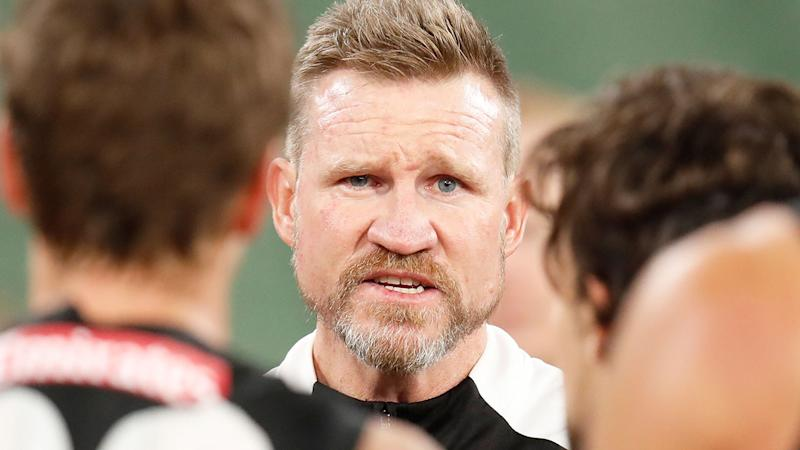Pictured here, Collingwood coach Nathan Buckley addressing his players.