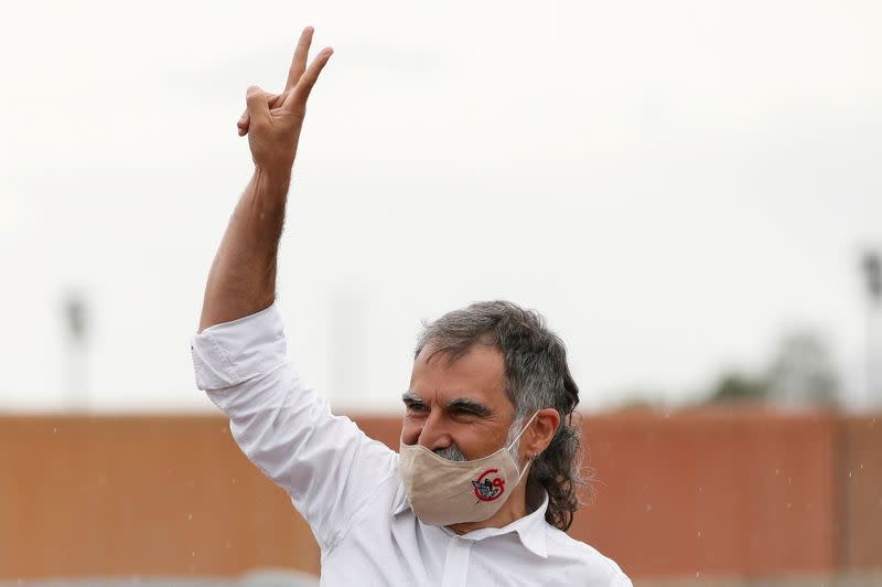 FILE PHOTO: Catalan leader Jordi Cuixart gestures in front of the Lledoners prison after the Spanish government announced a pardon for those who participated in Catalonia's failed 2017 independence bid, Sant Joan de Vilatorrada, near Barcelona, Spain, June