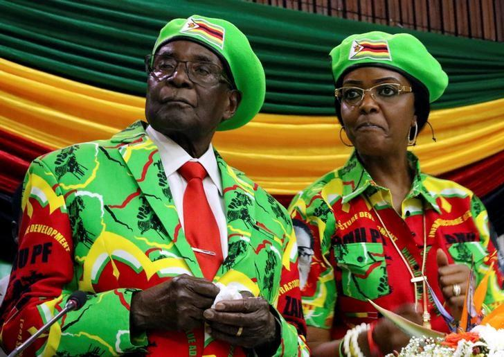 Zimbabwean President Robert Mugabe and his wife Grace attend a meeting of his ruling ZANU PF party's youth league in Harare