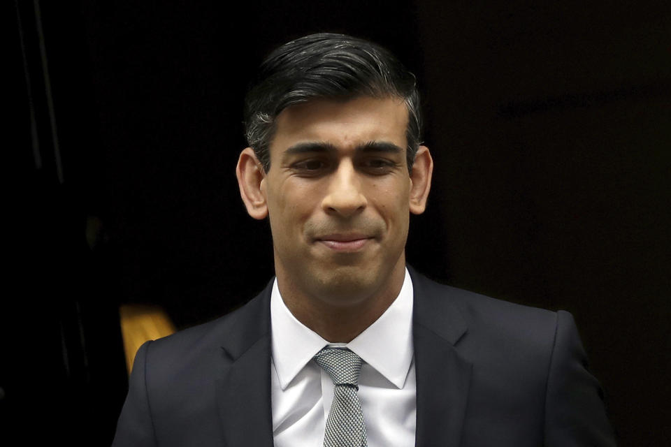British Chancellor of the Exchequer Rishi Sunak leaves number 11 Downing Street, to deliver a financial announcement to the Houses of Parliament in London, Wednesday, July 8, 2020. British Treasury chief Rishi Sunak on Wednesday is set to announce a 2-billion-pound ($2.5 billion) program to create jobs for young people as the government tries to revive an economy battered by the COVID-19 pandemic. (AP Photo/Matt Dunham)
