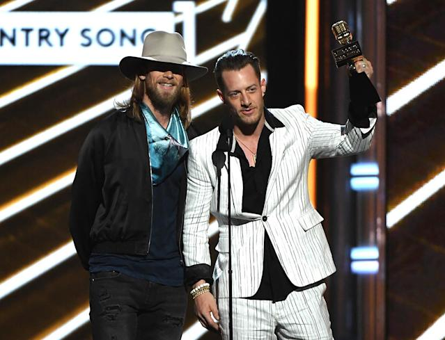 <p>Brian Kelley (L) and Tyler Hubbard of Florida Georgia Line accept Top Country Song for 'H.O.L.Y.' onstage during the 2017 Billboard Music Awards at T-Mobile Arena on May 21, 2017 in Las Vegas, Nevada. (Photo by Ethan Miller/Getty Images) </p>