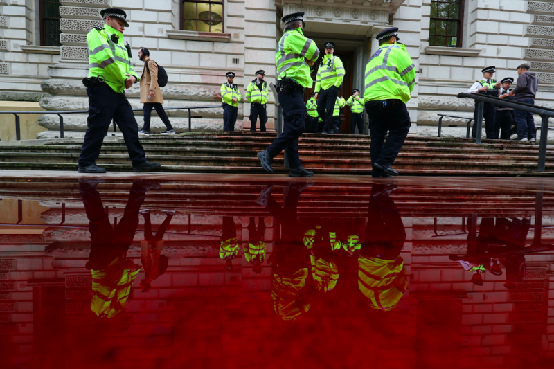 The Treasury building in Westminster has been covered in 1,800 litres of fake blood (PA)