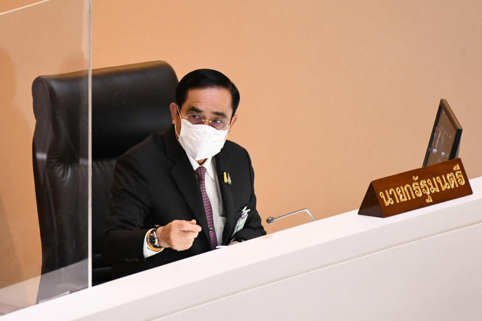 FILE – In this Tuesday, Aug. 31, 2021, file photo released by Public Relations Dpt. Lower House, Thailand's Prime Minister Prayuth Chan-ocha arrives at the parliament in Bangkok, Thailand. Thai lawmakers are due to vote Saturday, Sept. 4, 2021 on no-confidence motions filed against Prayuth and five members of his Cabinet, after four days of opposition criticism were overshadowed by heady speculation that his own allies might try to unseat him.(Public Relations Dpt. Lower House via AP, File)