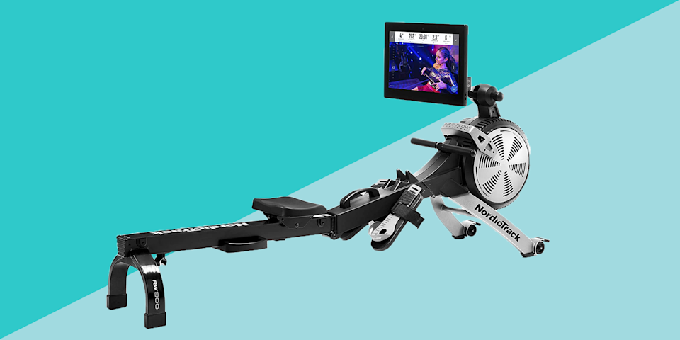 """<p>Why are at-home rowing machines so popular right now? Because they offer a <a href=""""https://www.prevention.com/fitness/workouts/"""" rel=""""nofollow noopener"""" target=""""_blank"""" data-ylk=""""slk:full-body workout"""" class=""""link rapid-noclick-resp"""">full-body workout</a> in one compact piece of equipment. As you invest in your <a href=""""https://www.prevention.com/fitness/workout-clothes-gear/g34645393/best-home-gym-equipment/"""" rel=""""nofollow noopener"""" target=""""_blank"""" data-ylk=""""slk:home gym"""" class=""""link rapid-noclick-resp"""">home gym</a>, consider adding a rowing machine alongside your <a href=""""https://www.prevention.com/fitness/workout-clothes-gear/g28969031/best-treadmills/"""" rel=""""nofollow noopener"""" target=""""_blank"""" data-ylk=""""slk:treadmill"""" class=""""link rapid-noclick-resp"""">treadmill</a> and your weight set—it offers a low-impact, total-body workout in about 20 minutes.</p><p>Just ask Nick Karwoski, a <a href=""""https://hydrow.com/"""" rel=""""nofollow noopener"""" target=""""_blank"""" data-ylk=""""slk:Hydrow"""" class=""""link rapid-noclick-resp"""">Hydrow</a> athlete and triathlete. """"Using a rowing machine is one of the most efficient ways to get a cardiovascular and <a href=""""https://www.prevention.com/fitness/fitness-tips/a26765994/benefits-of-lifting-weights/"""" rel=""""nofollow noopener"""" target=""""_blank"""" data-ylk=""""slk:strength training"""" class=""""link rapid-noclick-resp"""">strength training</a> workout in a short amount of time,"""" he says. """"We live in an ever-stressed world, where we're constantly sitting and rounding our backs, but rowing helps correct this by engaging those lats and sitting upright."""" Sounds, pretty good, right?</p><h3 class=""""body-h3"""">What is a rowing machine, exactly? </h3><p>A rowing machine mimics what it feels like to row a boat: The resistance of the """"water"""" increases your heart rate and builds strength. And unlike running and other high-impact exercises like <a href=""""https://www.prevention.com/fitness/workouts/a25995418/hiit-training-workouts-benefits/"""" rel=""""nofollow noopener"""" target=""""_blank"""" da"""