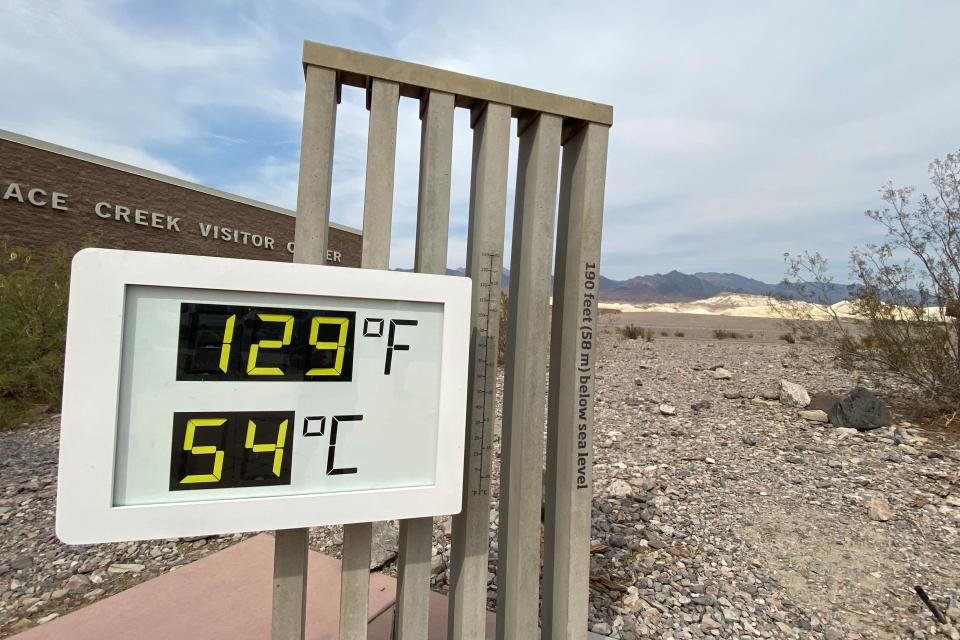 The thermometer at the Furnace Creek Visitor Center at Death Valley National Park shows temperatures reading 129 degrees Fahrenheit (53.8 C) in Death Valley, California, U.S. June 16, 2021. Picture taken June 16, 2021.  REUTERS/Norma Galeana