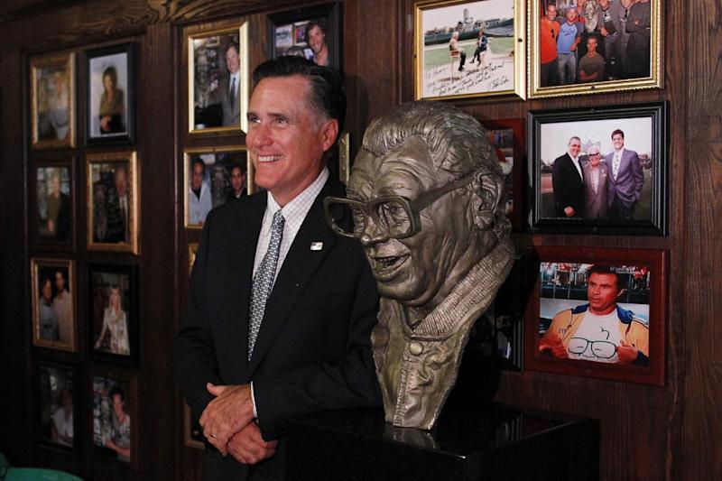 Republican presidential candidate, former Massachusetts Gov. Mitt Romney poses nest to a bust of  famed baseball announcer, Harry Caray after a private fundraising event at Harry Caray's Italian Steakhouse restaurant in Chicago, Tuesday, Aug. 7, 2012. (AP Photo/Charles Dharapak)