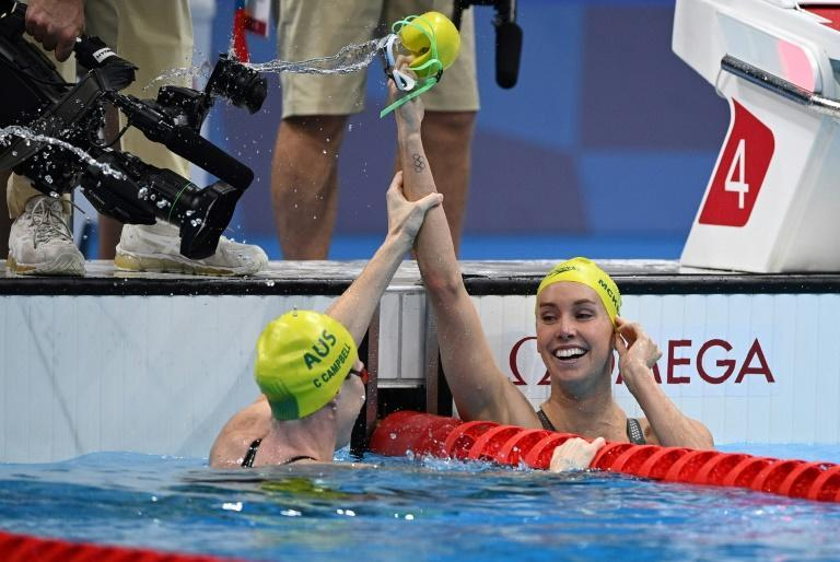 First-placed Australia's Emma McKeon (R) celebrates with third-placed Australia's Cate Campbell after winning the final of the women's 100m freestyle swimming event
