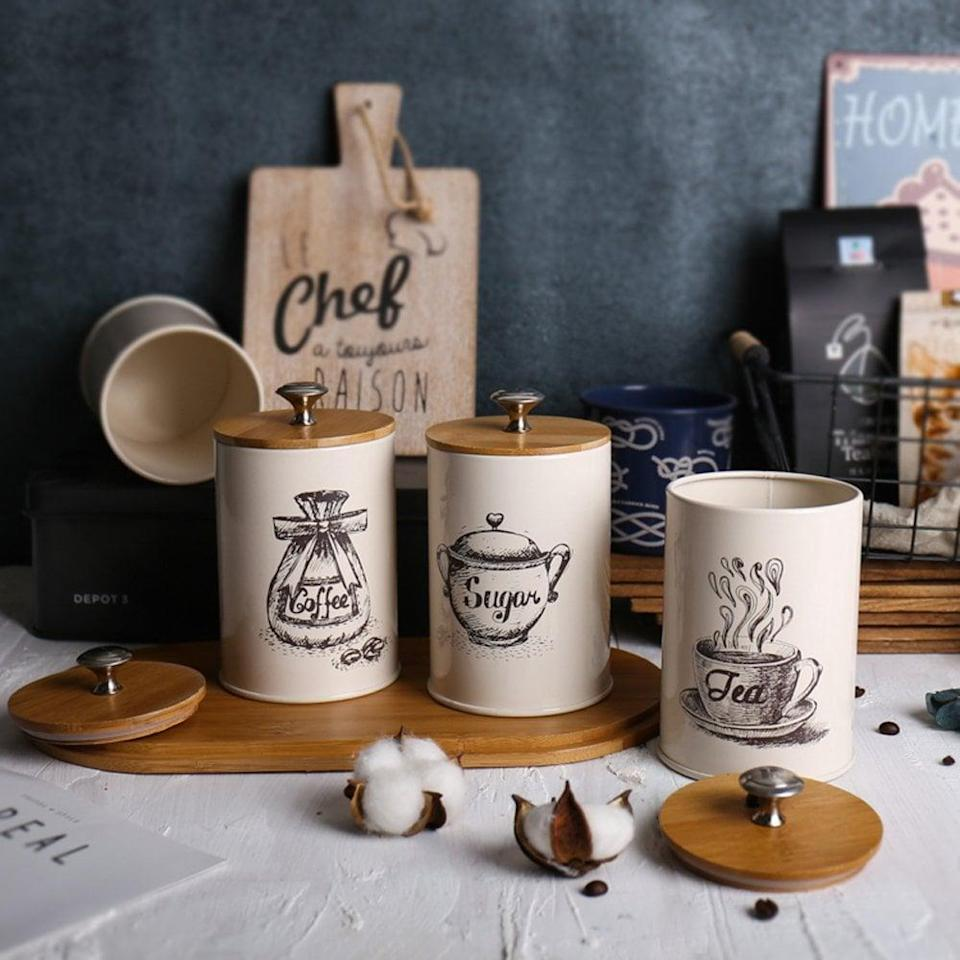 <p>We love the illustrations on these <span>Metal Storage Tin Canisters With Bamboo Lids</span> ($20, set of three).</p>