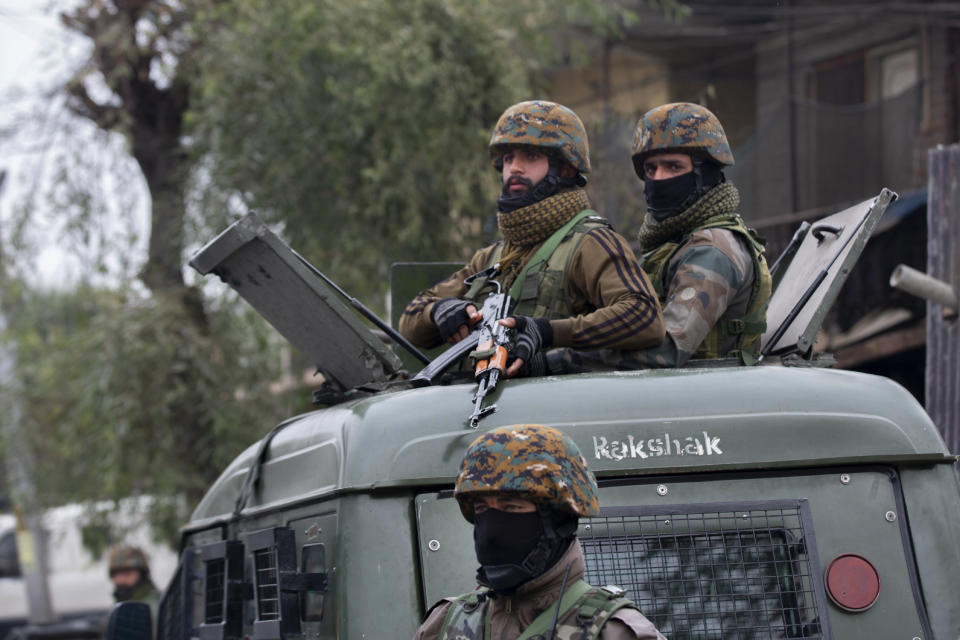 Indian army soldiers stand guard near the site of a gun battle on the outskirts of Srinagar, Indian controlled Kashmir, Sunday, Nov. 1, 2020. According to police, Indian government forces killed Saifullah Mir, a top rebel commander of the region's largest rebel group, Hizbul Mujahideen which has spearheaded an armed rebellion against Indian rule for decades. (AP Photo/ Dar Yasin)
