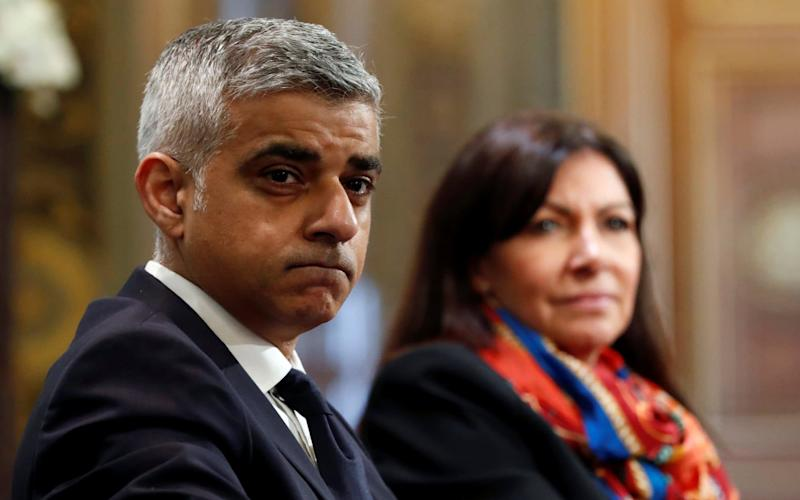 London Mayor Sadiq Khan and Paris Mayor Anne Hidalgo attend a meeting on air pollution in Paris - Credit: GONZALO FUENTES/REUTERS