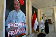 Father Nazeer Dako arranges a Vatican flag to welcome Pope Francis at St. Joseph's Chaldean Church ahead of the Pope's visit, in Baghdad, Iraq, Tuesday, March 2, 2021. (AP/Photo/Khalid Mohammed)