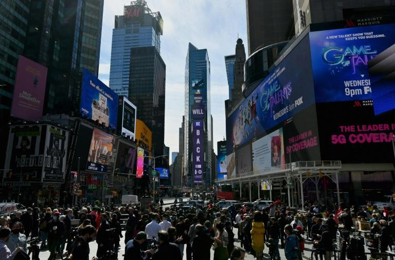 People watch the Time Square event on the one year anniversary of Broadway's closure