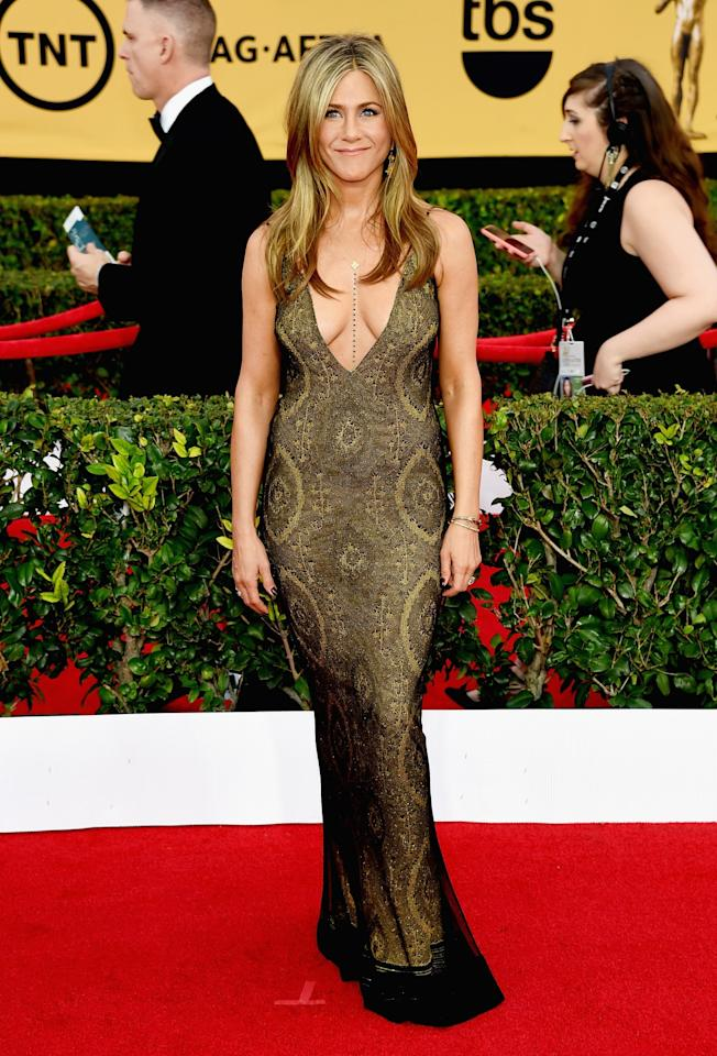 <p>Jennifer donned vintage Galliano at the 2015 SAG Awards in the form of a low-cut bronze gown. <i>[Photo: Getty]</i> </p>