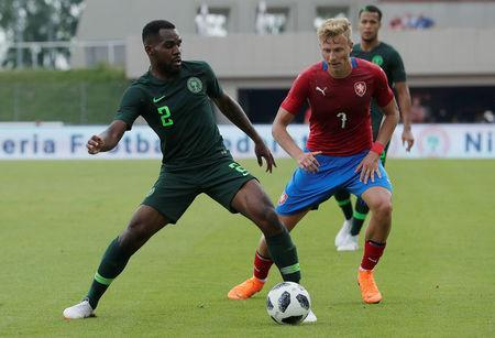 Nigeria's Brian Idowu in action with Czech Republic's Antonin Barak REUTERS/Heinz-Peter Bader