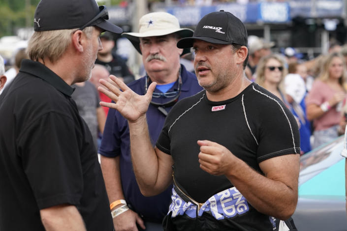 FILE - Tony Stewart talks before an SRX Series auto race in Nashville, in this Saturday, July 17, 2021, file photo. Stewart, who fell in love with NHRA while tagging along with fiancée Leah Pruett at her races the past two seasons, will be an official part of the sport in 2022. The NASCAR Hall of Fame driver will add two fulltime NHRA entries to Tony Stewart Racing next season — a Top Fuel entry for Pruett and a Funny Car for Matt Hagan. (AP Photo/Mark Humphrey, File)