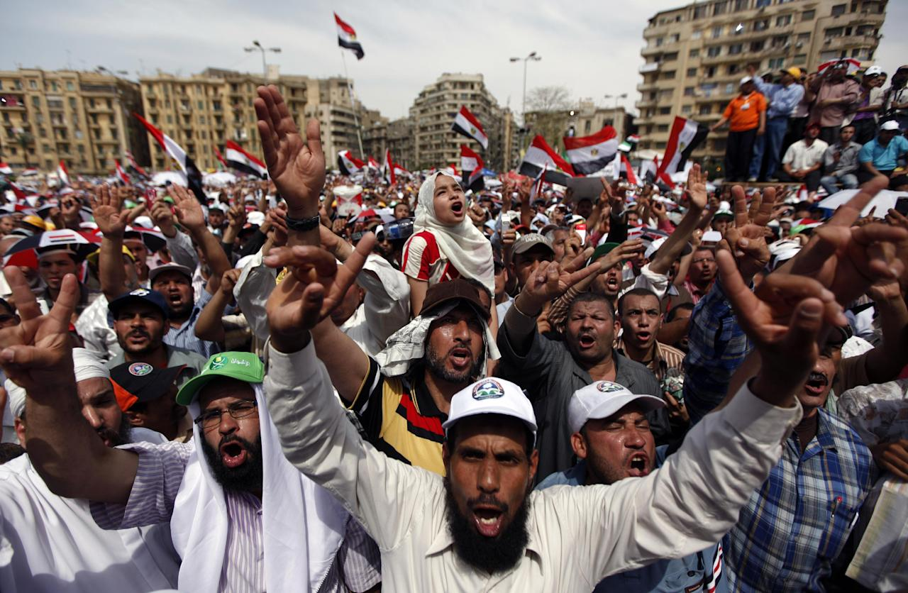 Egyptians chant slogans as they protest in Tahrir square in Cairo, Egypt, Friday, May 4, 2012. Thousands rallied in Egypt against the country's ruling military council on Friday, two days after a flare-up of street violence left at least nine dead and fueled a wave of Islamist-led opposition to the generals ahead of presidential elections. (AP Photo/Khalil Hamra)