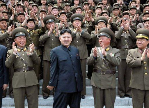 North Korean leader Kim Jong-Un surrounded by military officers in Pyongyang in May 2012. The North's military has in recent months ratcheted up hostile rhetoric towards South Korea and its President Lee Myung-Bak, partly in a bid to burnish Kim Jong-Un's credentials