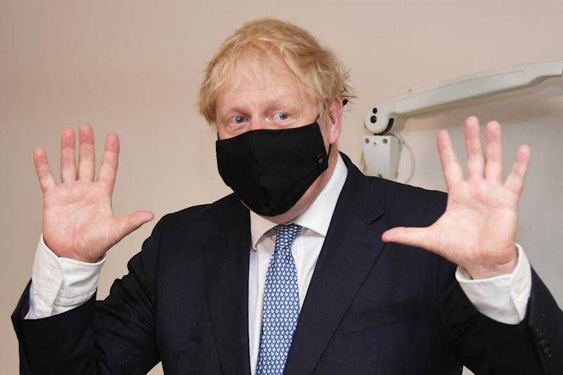 LONDON, ENGLAND - JULY 24: (Alternate crop of #1227758502) Prime minister Boris Johnson wears a face mask as he visits Tollgate Medical Centre in Beckton on July 24, 2020 in London, England. (Photo by Jeremy Selwyn - WPA Pool/Getty Images)