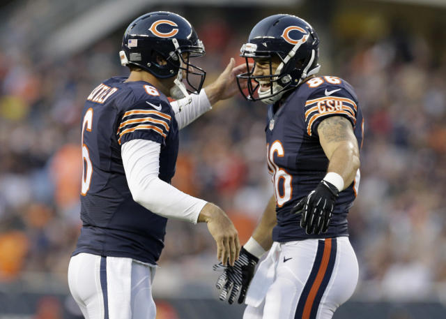 Chicago Bears quarterback Jay Cutler (6) celebrates a touchdown with tight end Zach Miller (86) in the first half of an NFL preseason football game against the Philadelphia Eagles on Friday, Aug. 8, 2014, in Chicago. (AP Photo/Nam Y. Huh)