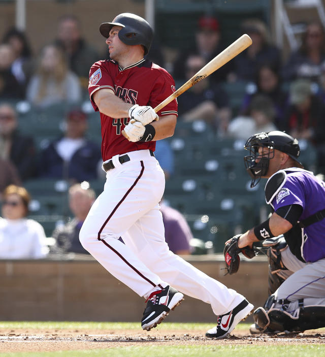 FILE - In this Feb. 28, 2018, file photo, Arizona Diamondbacks' Paul Goldschmidt swings for an RBI single in the first inning of a spring training baseball game against the Colorado Rockies, in Scottsdale, Ariz. The quiet anchor of this team is the five-time All-Star first baseman, who remains one of baseballs biggest bargains from a contract he signed long ago when he was just emerging as a star. (AP Photo/Ben Margot, File)