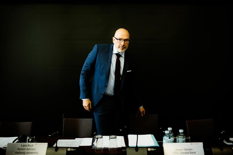 """(Bloomberg) -- Denmark's biggest bank, already struggling to recover from a money-laundering scandal, fired the man who until last month was interim CEO because some clients paid too much for an investment product.Danske Bank A/S said Monday that it had dismissed Jesper Nielsen, head of banking in Denmark, after it emerged that tens of thousands of domestic customers were improperly charged. The lender now owes them a total of 400 million kroner ($61 million) in compensation.Nielsen, 50, ran the bank as interim CEO following the $230 billion dirty-money debacle and was tipped as a potential permanent leader before Danske picked Chris Vogelzang, a former ABN Amro banker, for the top job. The bank's shares have plunged 60% since early 2018, as the laundering affair unfolded, and fell as much as 2.7% after Monday's announcement.Nielsen """"did not to a sufficient degree ensure that the Flexinvest Fri product was suitable for the bank's customers,"""" Chairman Karsten Dybvad said in a statement. """"Therefore, we find that Jesper cannot continue in his position.""""Danske fired CEO Thomas Borgen in October over the laundering scandal and Nielsen had acted as interim CEO until June. Nielsen, a Danish national, had been with Danske since 1996.Vogelzang apologized to clients in a statement. """"Misguided management decisions"""" meant that Danske didn't give customers """"proper advice,"""" he said. """"We will take all the steps necessary to prevent something similar from happening again in future.""""Danske said that 87,000 customers were overcharged during the implementation of new MiFID II regulation in 2017. The bank said the fees were too high compared with expected returns in a low-interest environment, making the product """"unsuitable for some customers.""""While Danske searches for a replacement for Nielsen, Glenn Soederholm, who's head of banking in the other four Nordic countries, will take over the Danish banking division.Danske said it had informed the Danish Financial Supervisory Authority, wh"""