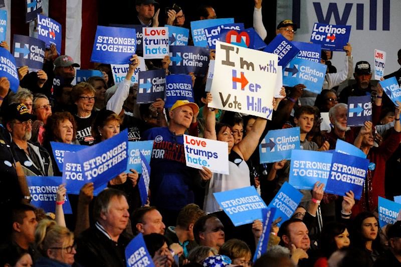 While middle-class whites generally favor Donald Trump, Hillary Clinton has syphoned off support among suburban, college-educated Republicans who can't stomach the idea of a Trump presidency (AFP Photo/Jason Connolly)