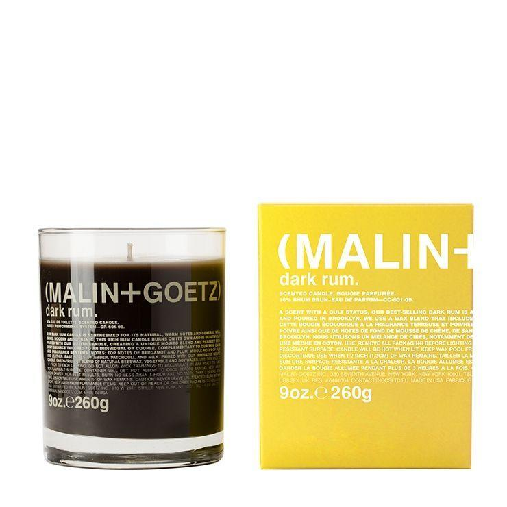 """Spruce up his bedroom or home with a warm rum scented candle. <br><br><strong>Malin + Goetz</strong> Dark Rum Candle, $, available at <a href=""""https://go.skimresources.com/?id=30283X879131&url=https%3A%2F%2Fwww.malinandgoetz.com%2Fdark-rum-candle-9oz-e260g"""" rel=""""nofollow noopener"""" target=""""_blank"""" data-ylk=""""slk:Malin + Goetz"""" class=""""link rapid-noclick-resp"""">Malin + Goetz</a>"""