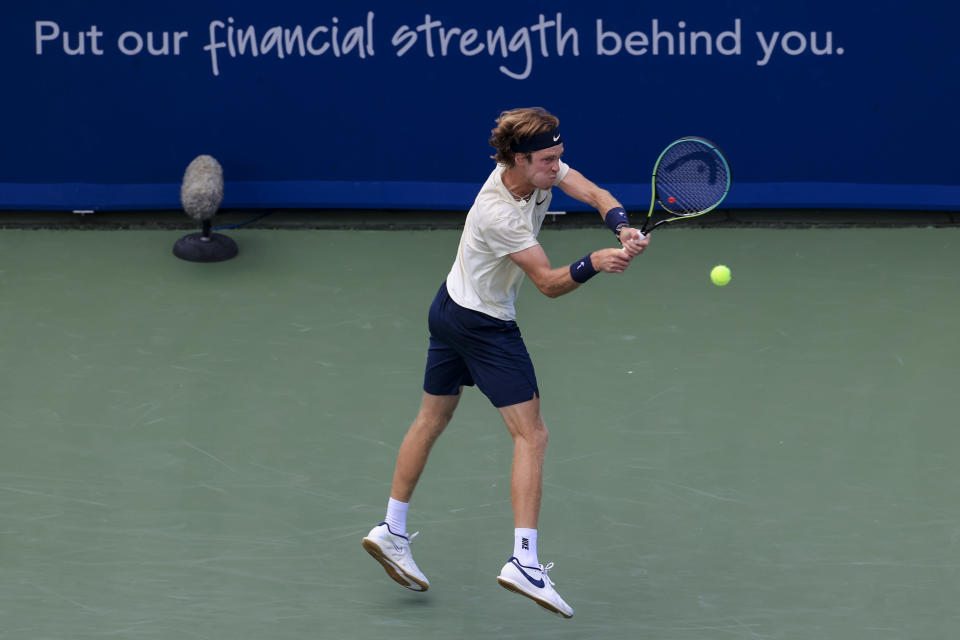Andrey Rublev, of Russia, returns to Alexander Zverev, of Germany, during the men's single final of the Western & Southern Open tennis tournament Sunday, Aug. 22, 2021, in Mason, Ohio. (AP Photo/Aaron Doster)